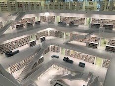 Photo of a large library's book stacks
